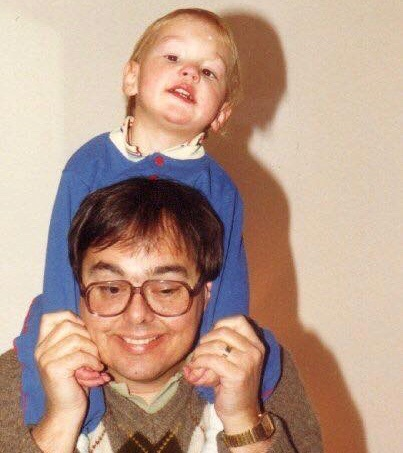 Dan O'Connor riding on his father Martin's shoulders
