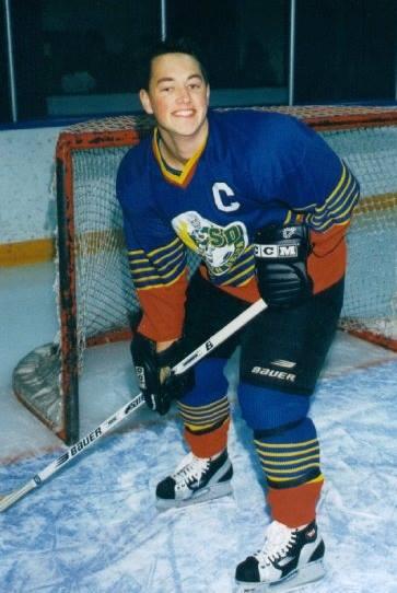 Dan O'Connor as a teen posing for his hockey photo